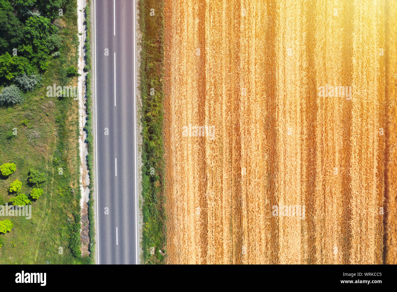 Farm land aerial view from above near country road, drone view ladnscape. Crops concept Stock Photo
