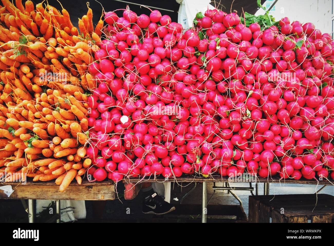 Heaps Of Carrots And Radishes On Table For Sale Stock Photo
