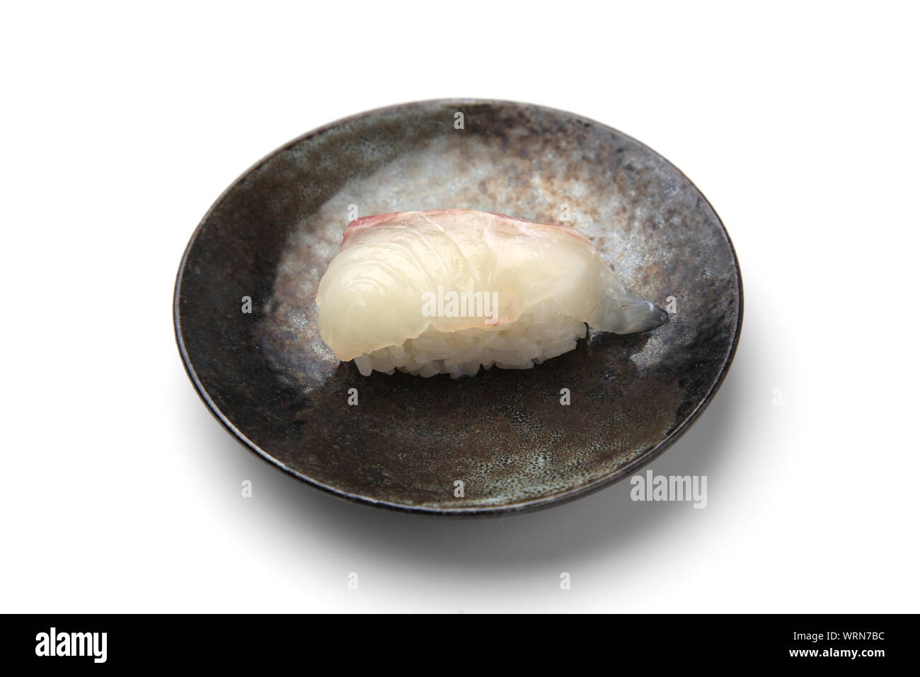 sushi of red snapper closeup isolated on white background Stock Photo