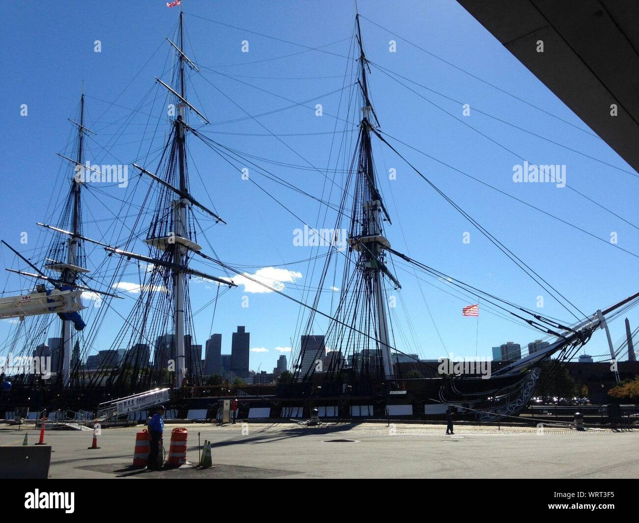 Uss Constitution Moored At Charlestown Navy Yard Against Blue Sky Stock Photo