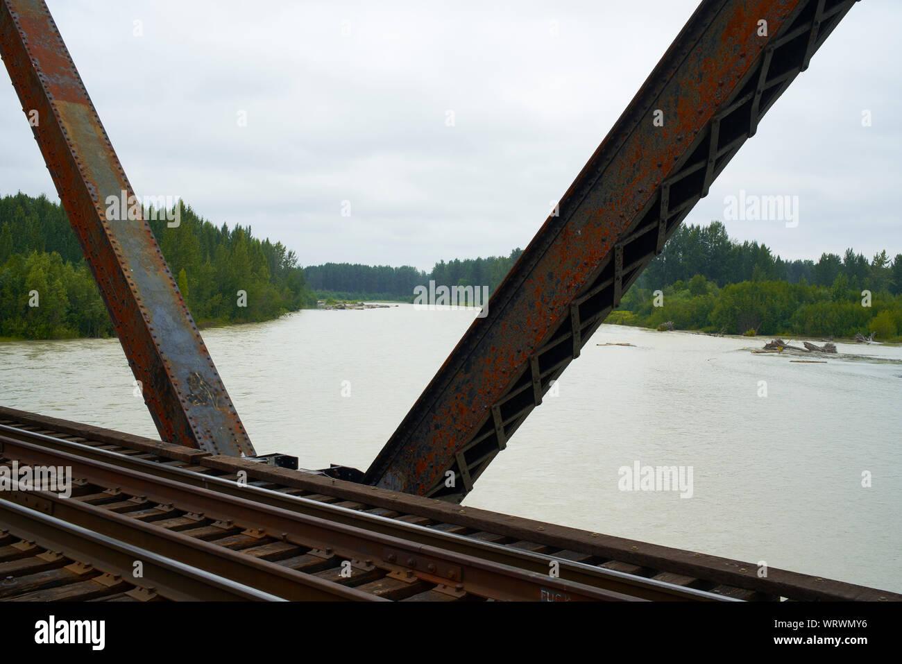 Train bridge over the Talkeetna river in Alaska. Stock Photo