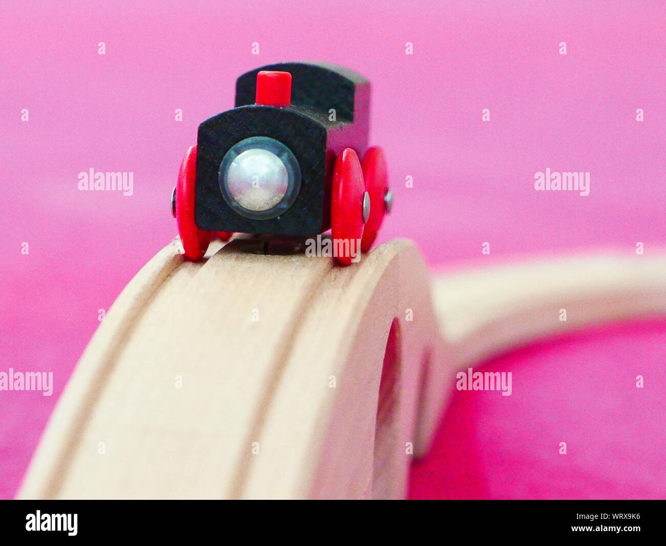 Toy Train On Wooden Railroad Track Stock Photo