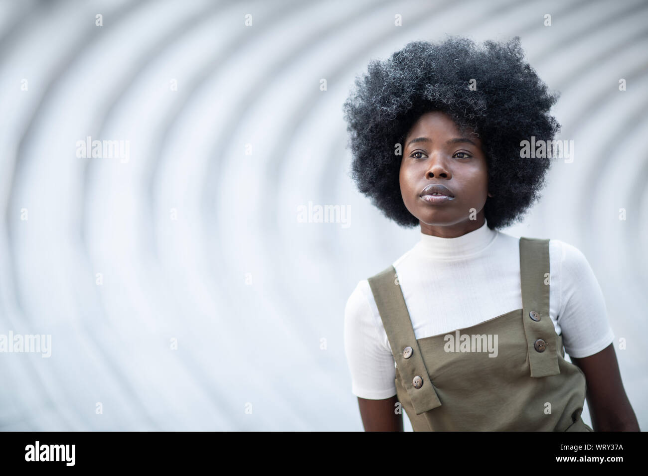 Young and beautiful black girl on an urban landscape, creative artistic photo Stock Photo