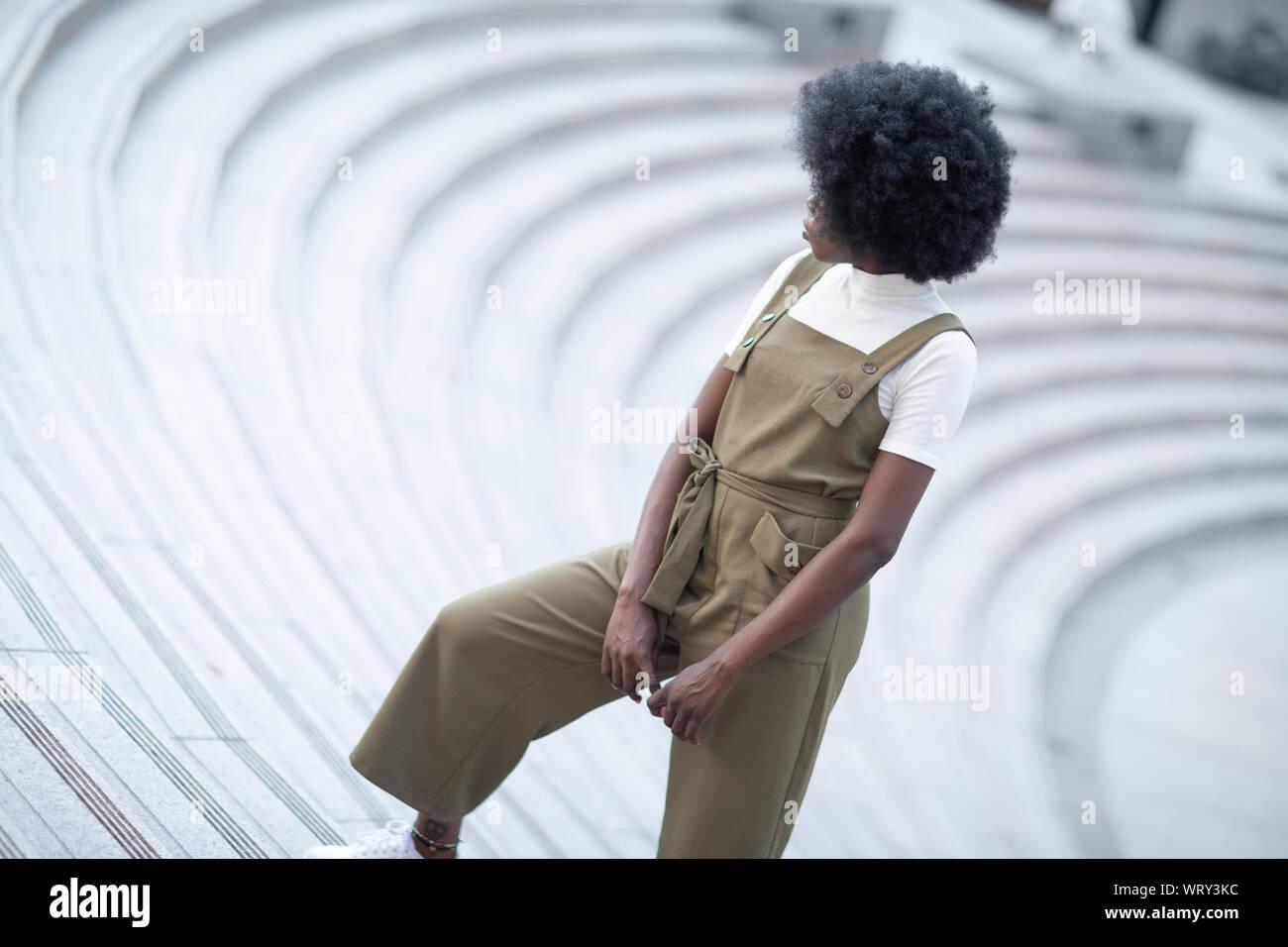 Young and beautiful black girl on an urban landscape, creative fashion shot Stock Photo