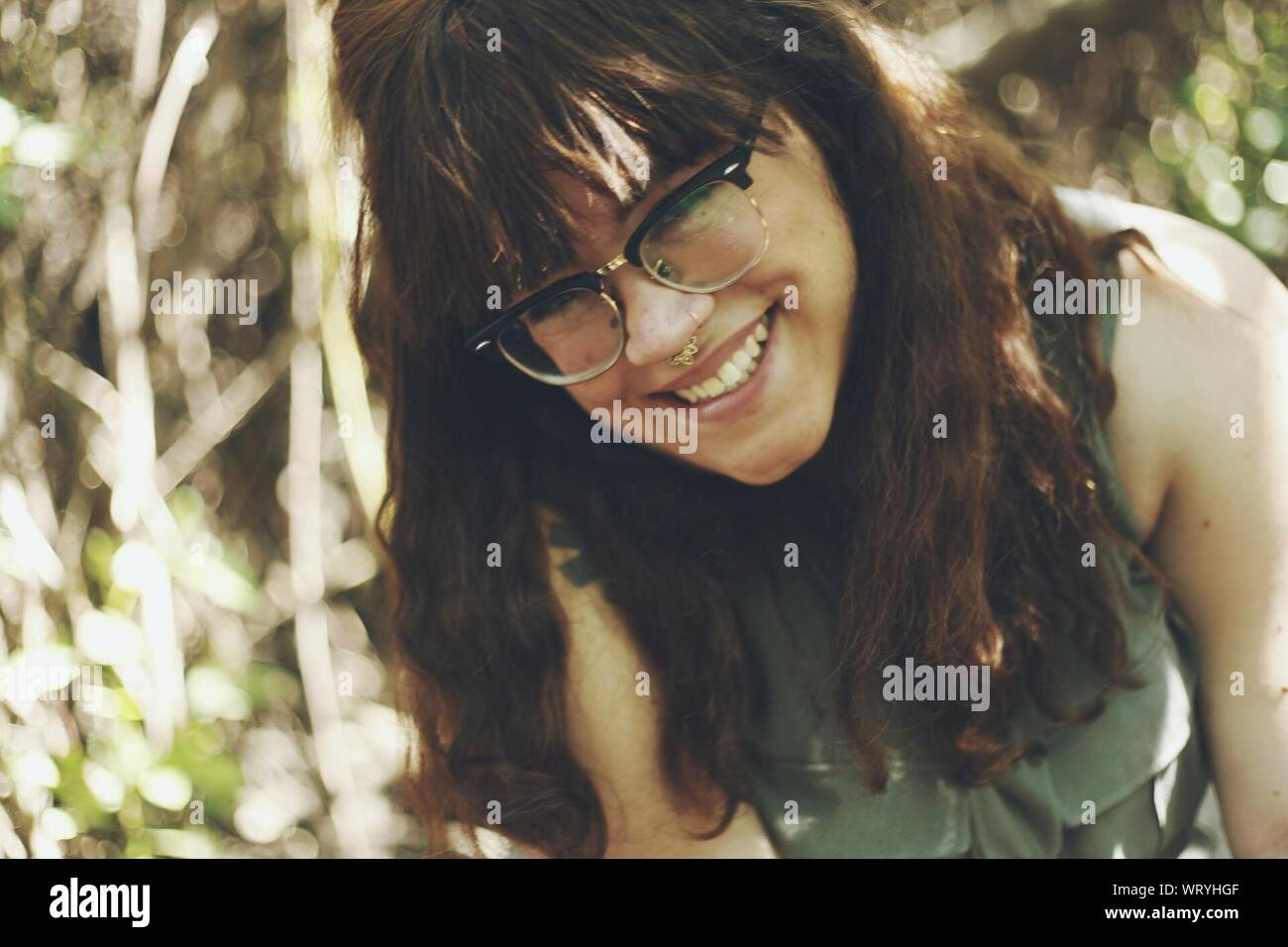 Close-up Portrait Of Smiling Young Woman Stock Photo