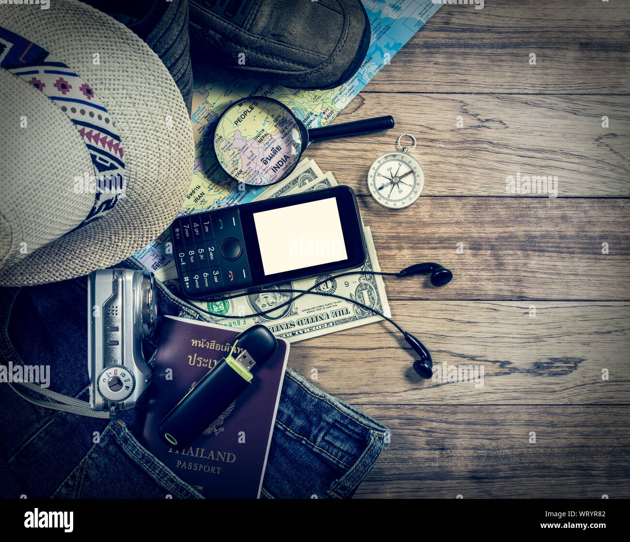 Set of travel accessory with mobile phone on wooden vintage background. Stock Photo