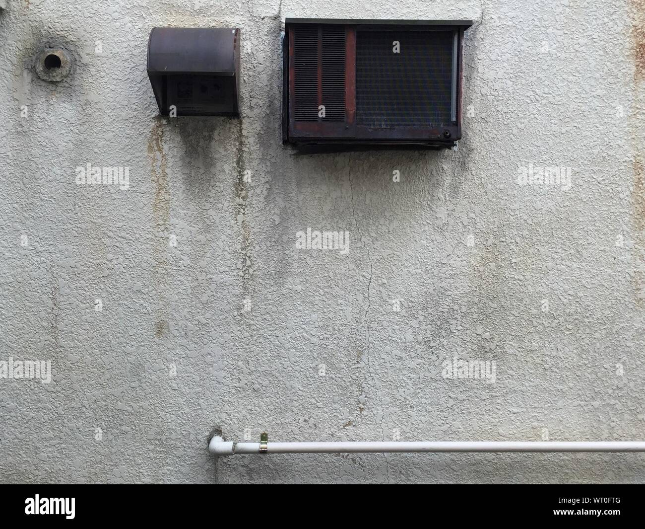 Air Conditioner And Duct With Pipe On Wall Stock Photo