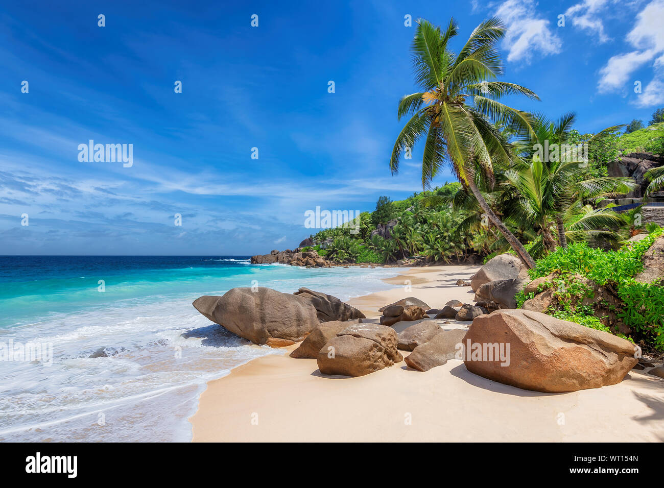Exotic beach with white sand and tropical sea on Paradise island. Stock Photo