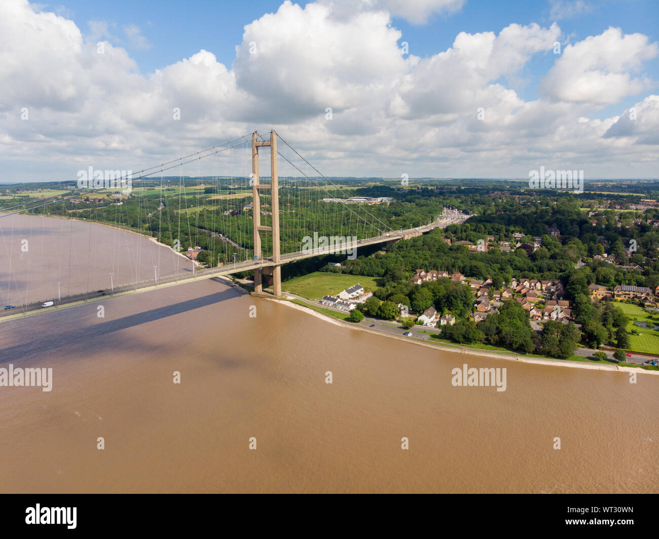 Wide photo of The Humber Bridge, near Kingston upon Hull, East Riding of Yorkshire, England, single-span road suspension bridge, taken on a sunny day Stock Photo
