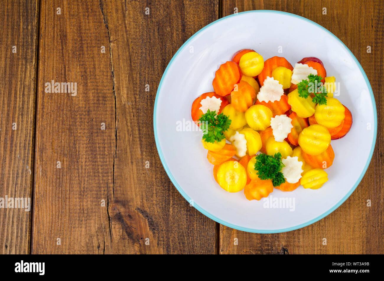 Dietary vegetable carrot salad on wooden background. Studio Photo Stock Photo