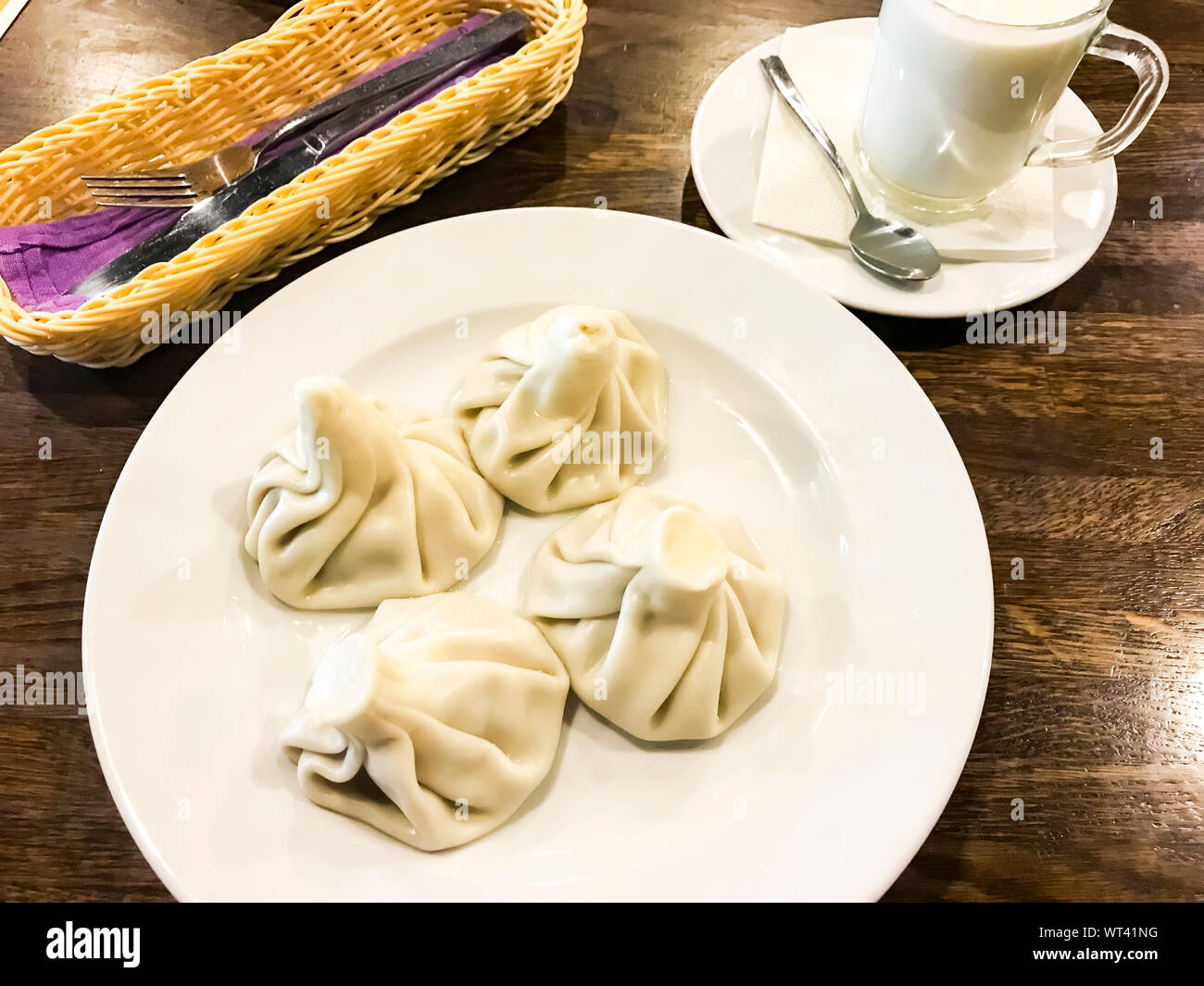 Dishes of Georgian cuisine. Khinkali with meat on plate. Studio Photo Stock Photo