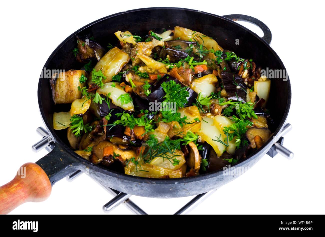 Vegetable stew pan saute isolated on white background. Studio Photo Stock Photo