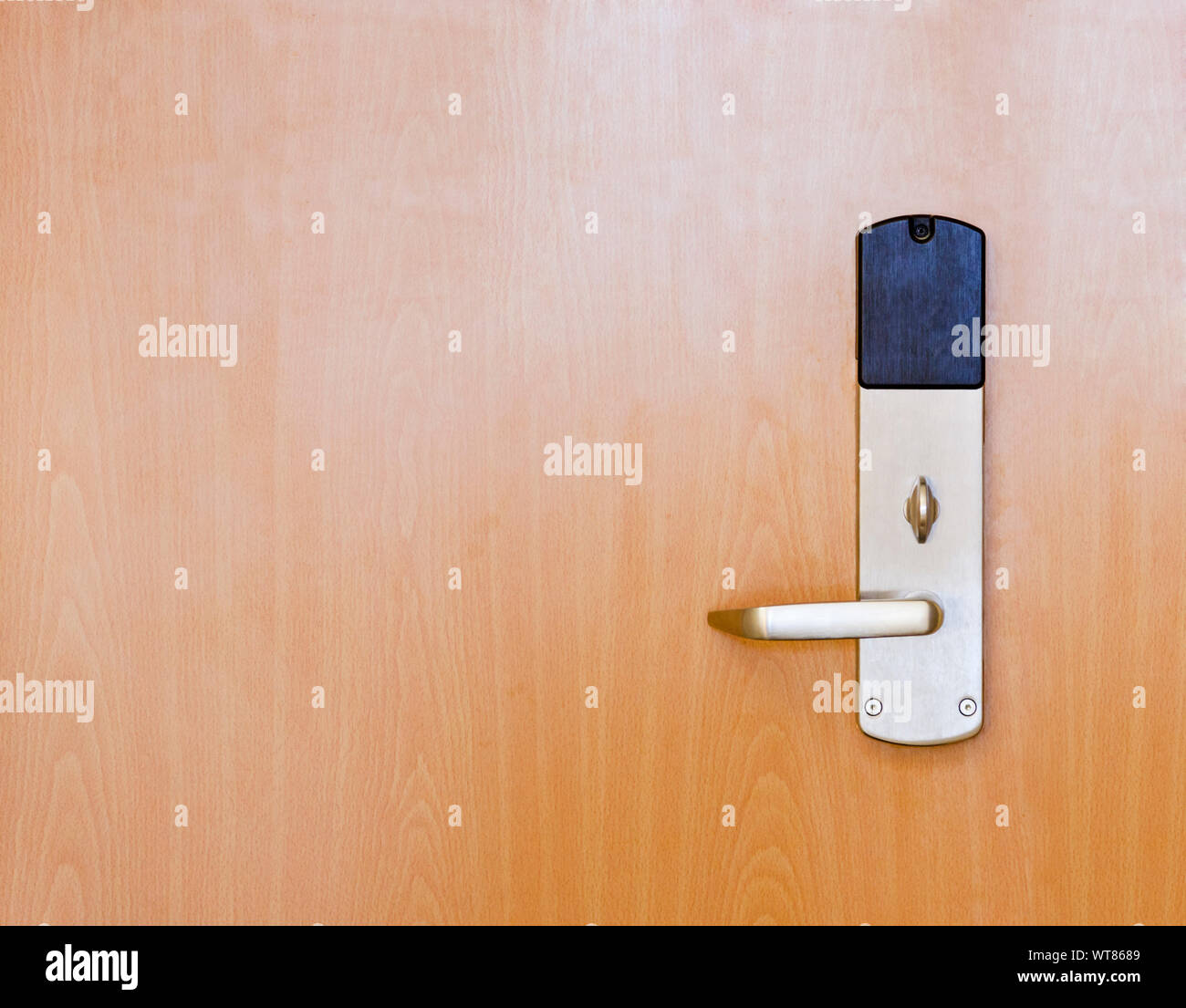 Section of a modern internal office door with handle and locking mechanism Stock Photo