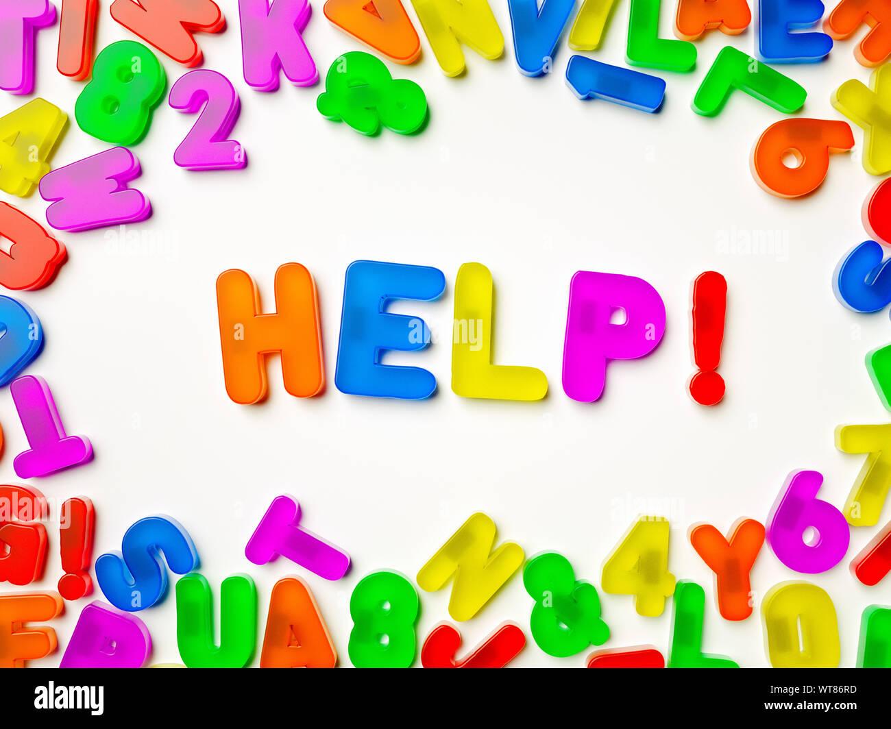 Plastic multi coloured fridge magnet alphabet spelling Help! Stock Photo