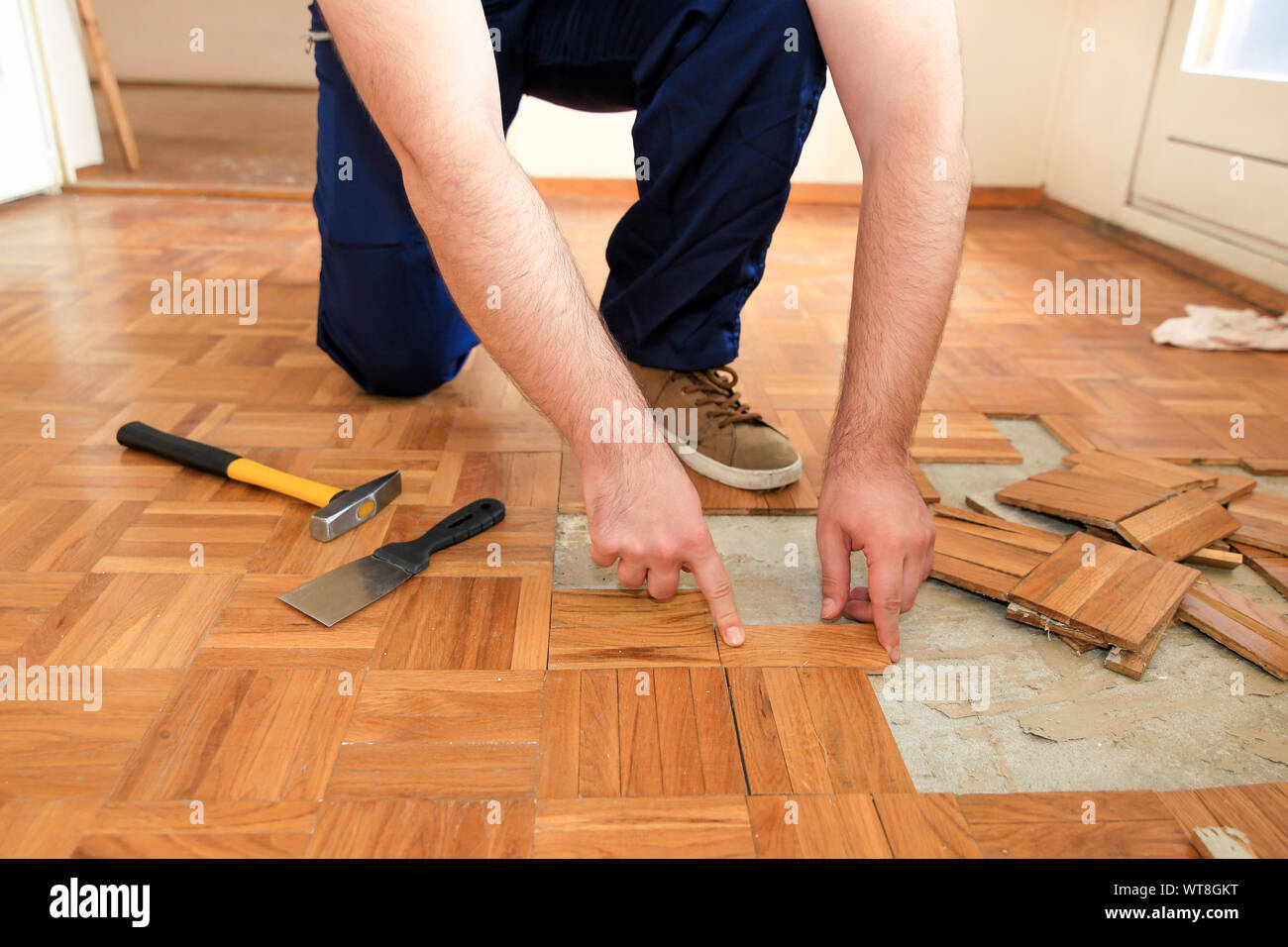 Construction Worker Is Working On Renovation Of Apartment