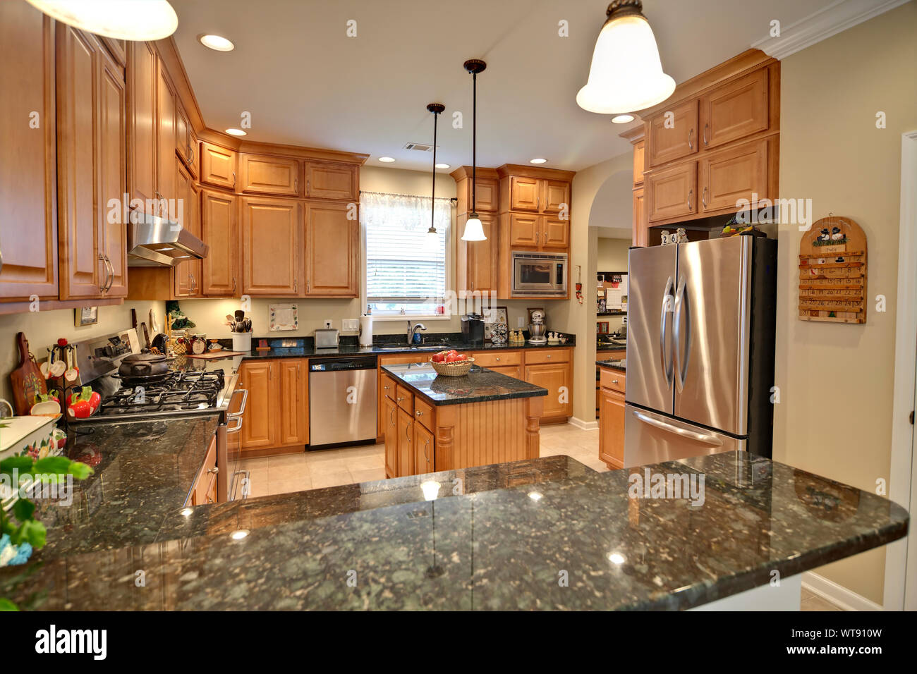spacious modern kitchen with maple cabinets and granite Stock ...