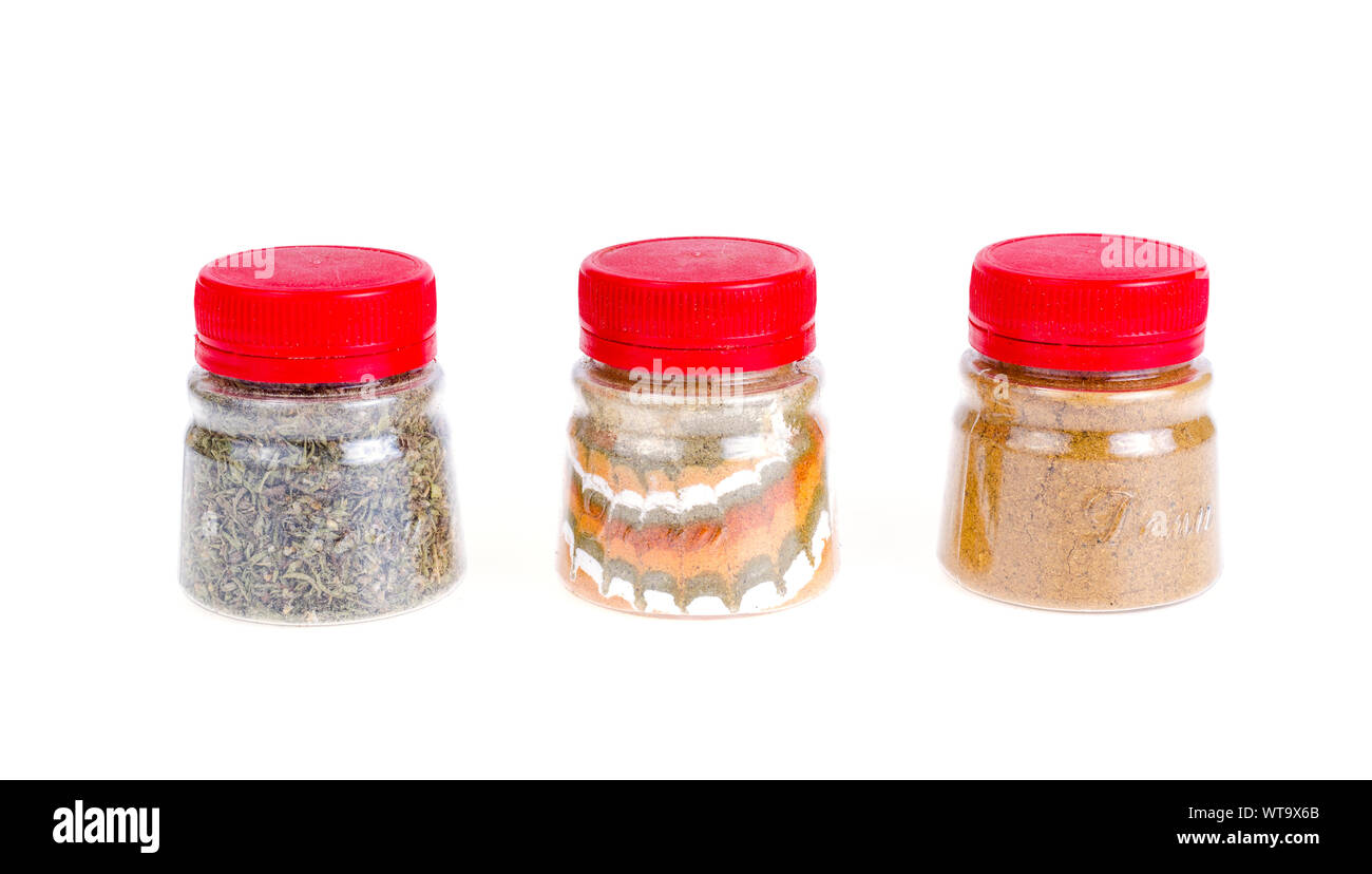 Jars with ground dried spices, herb. Studio Photo Stock Photo