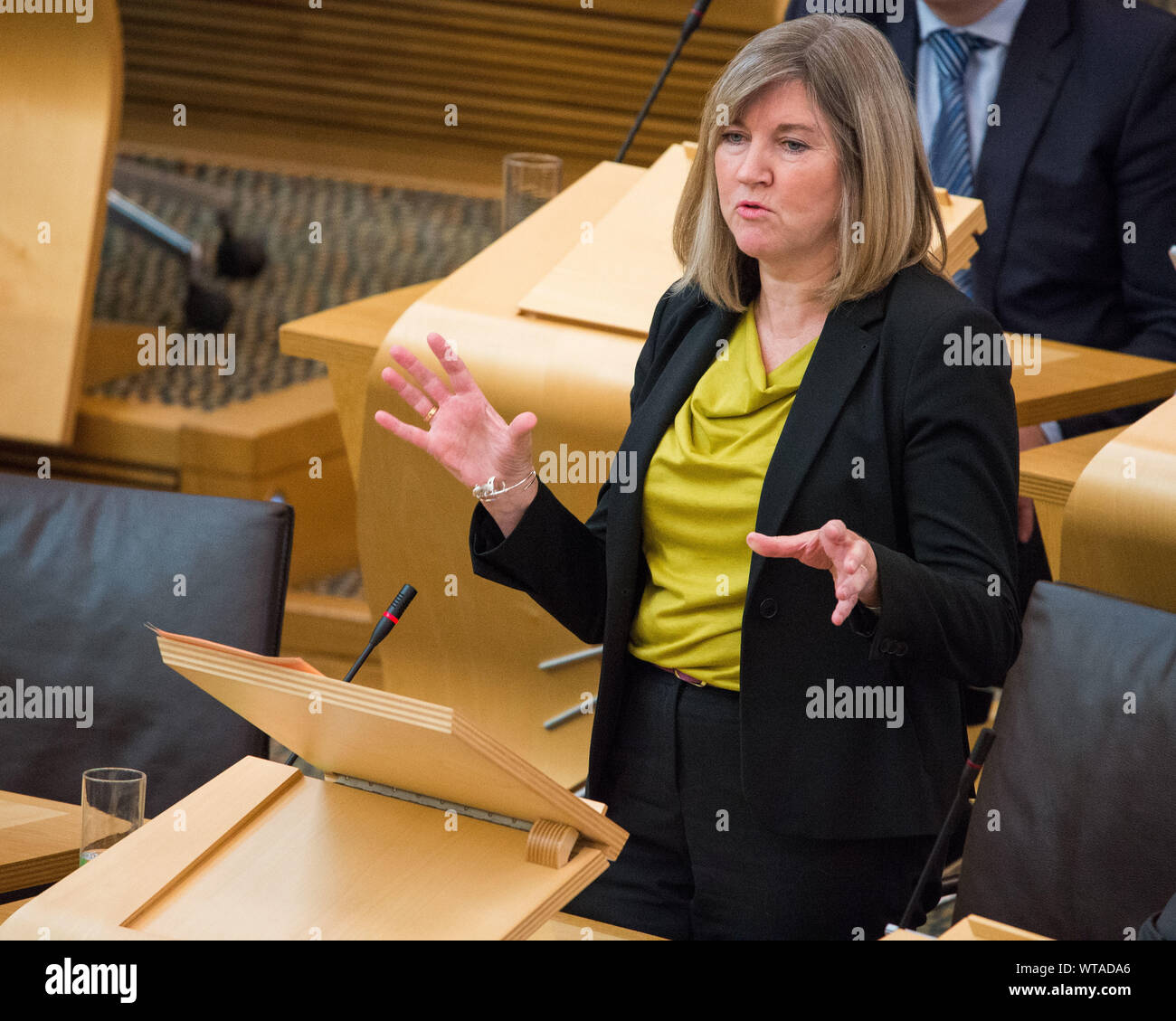 Edinburgh, UK. 5 September 2019. Pictured: Alison Johnstone MSP - Co-Leader of the Scotish Green Party, asking: Last week, we launched our proposals for a Scottish green new deal—a transformative programme of change that contrasts with the Scottish Government's lack of ambition. For example, we propose that the hundreds of millions of pounds that are being spent on new roads be redirected into public transport, cycling and walking. An independent review of the Scottish Government's clean air strategy that was published last week supports that. Will the First Minister be bold and take funds out Stock Photo