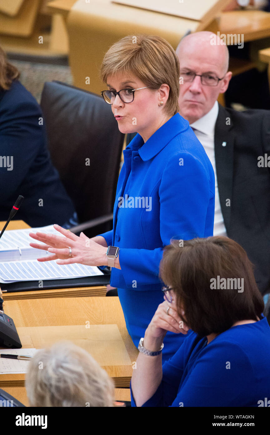 Edinburgh, UK. 5 September 2019. Pictured: (L-R) Nicola Sturgeon MSP - First Minister; John Swinney MSP - Depute First Minister; (bottom) Jeane Freeman - Health Minister. Nicola Sturgeon answers questions during the first session of First Ministers Questions after the summer recess. Questions centred around BREXIT, Independence, Finance, and Sectarian disorder.  Colin Fisher/CDFIMAGES.COM Stock Photo