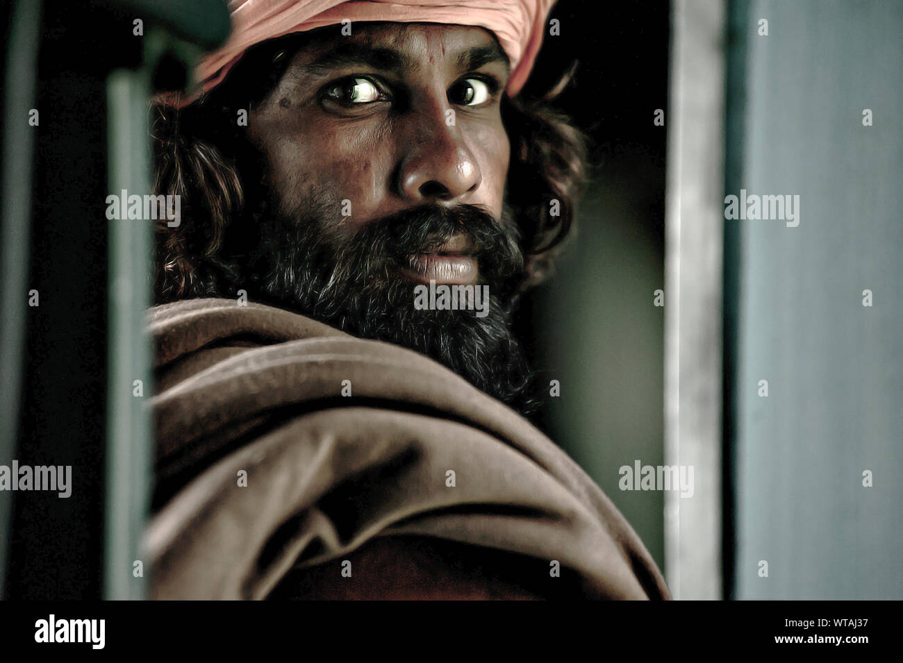 Indian man in a train travel Stock Photo
