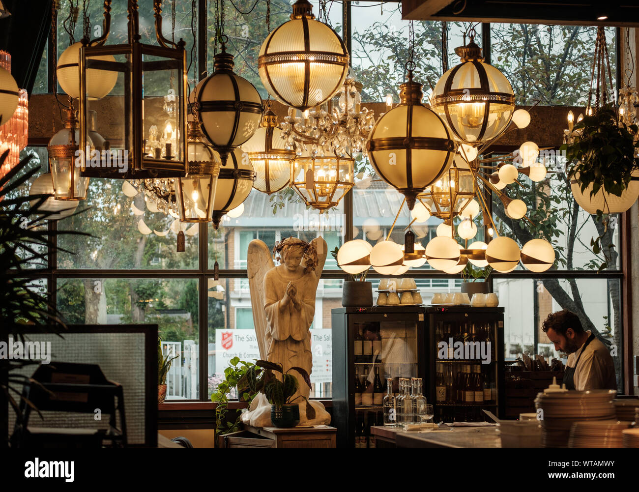 Trendy hipster interior decor at The Dining Room, Mare Street Market, Hackney, East London UK. Chandeliers by Pure White Lines. Stock Photo