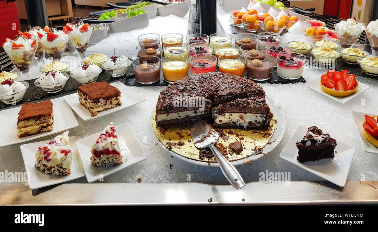 Buffet many cake, sweet on the food line, Different dessert cakes for sale at the shop. Stock Photo