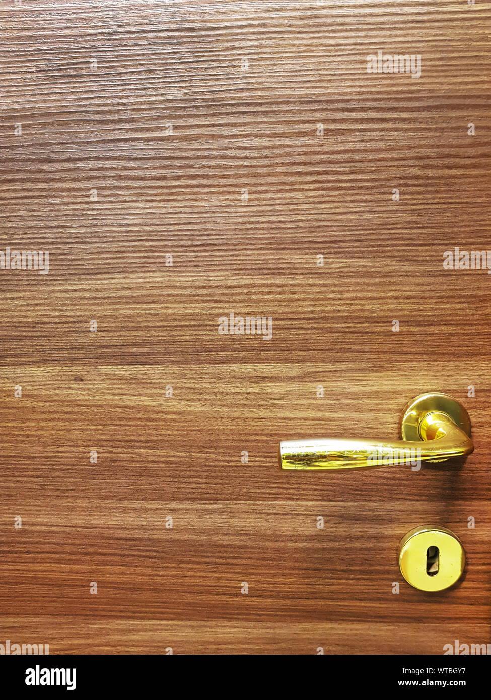 Modern wooden door with metal door handle,  Detail of wooden door background. Stock Photo