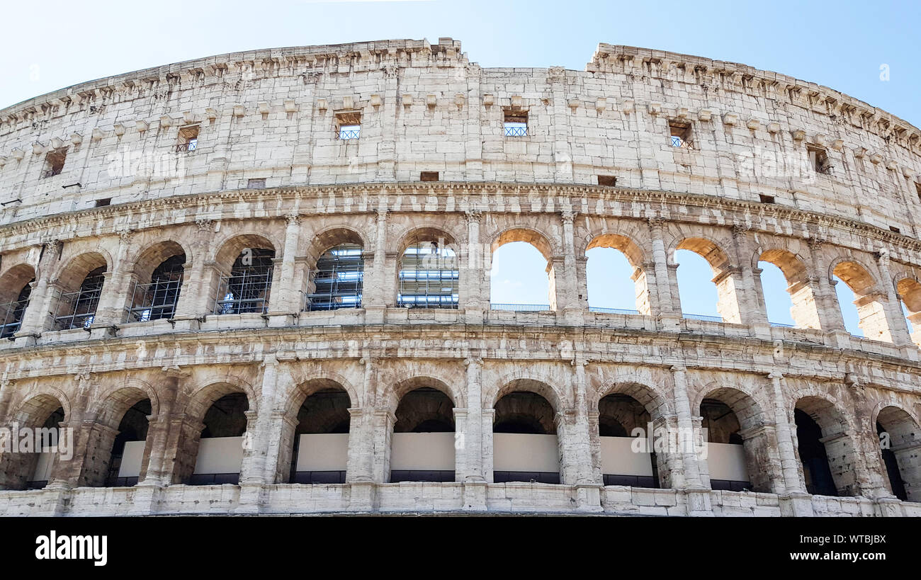 Colosseum in Rome, Italy, Architecture and landmark. Rome Colosseum is one of the main and famous attractions of Rome. Postcard of Rome. Stock Photo