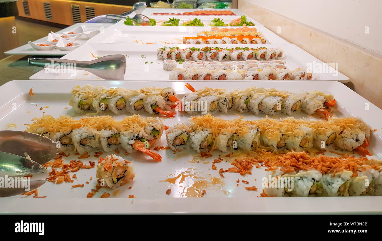 Mix of sushi buffet and rolls, Japanese traditional food, Dishes from raw fish in restaurant. Stock Photo