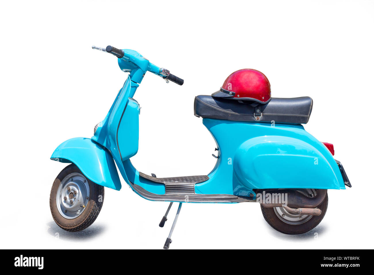 Retro scooter, Vintage scooter, retro motorcycle with red helmet isolated on white background with clipping path. Stock Photo