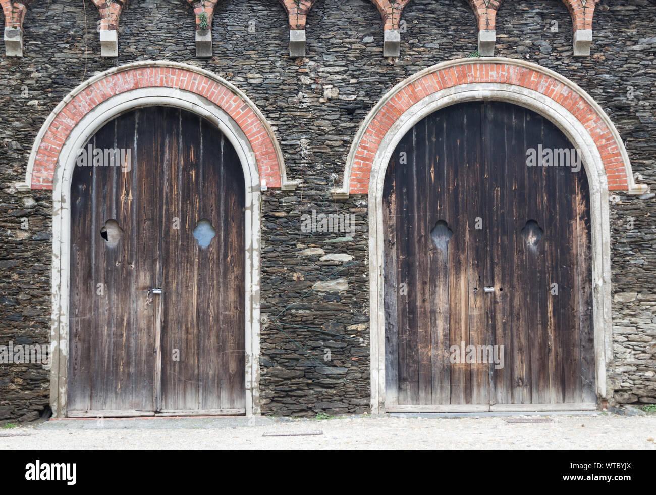 Ancient wooden door, old wooden doors of european building background. Stock Photo