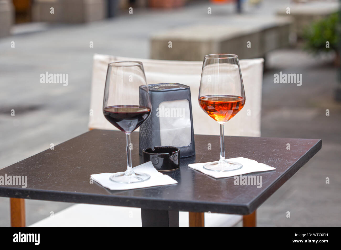 Outdoor two glass of wine on table outside the bar relaxing at holiday concept. Stock Photo