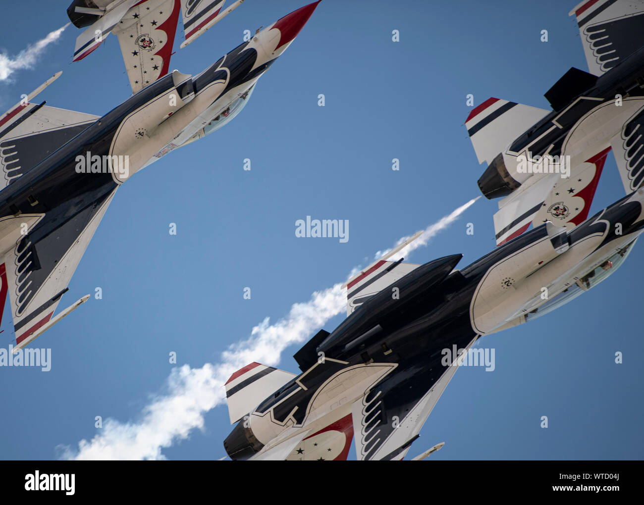 "The United States Air Force Air Demonstration Squadron ""Thunderbirds"" perform during the Grissom Air and Space Expo, Sept. 7, 2019, at Grissom Air Reserve Base, Ind. The Thunderbirds perform at more than 30 show sites each year, highlighting the pride, precision and professionalism of the Air Force. (U.S. Air Force photo by Senior Airman Andrew D. Sarver) Stock Photo"