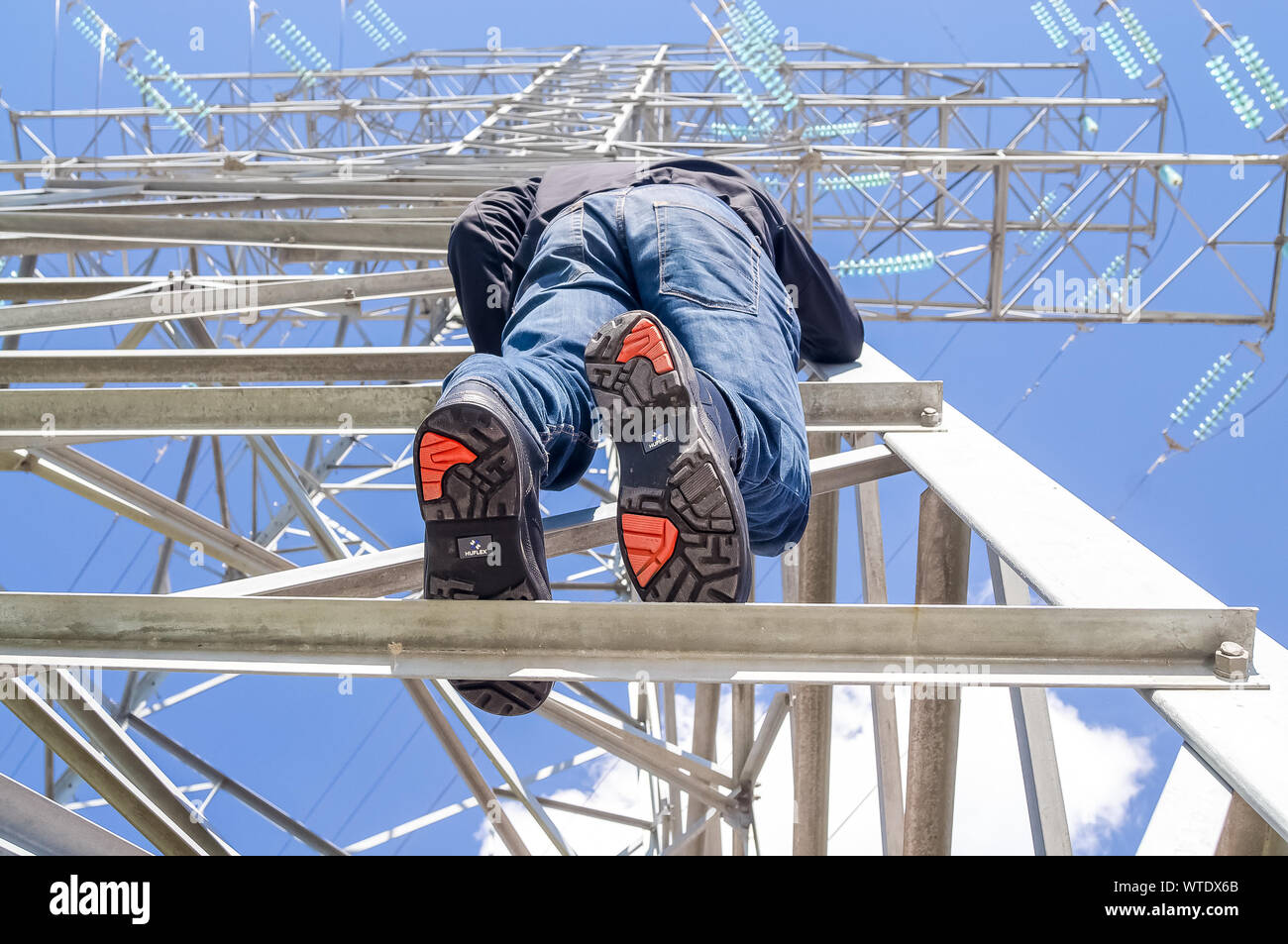 Lineman Worker Climbing On Transmission Line Tower Stock Photo Alamy