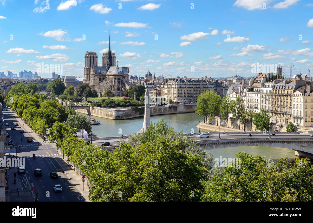 Top view of Paris taken from The Arab World Institute. The Pont de la Tournelle bridge spanning the river Seine, Notre-Dame Cathedral are observable. Stock Photo