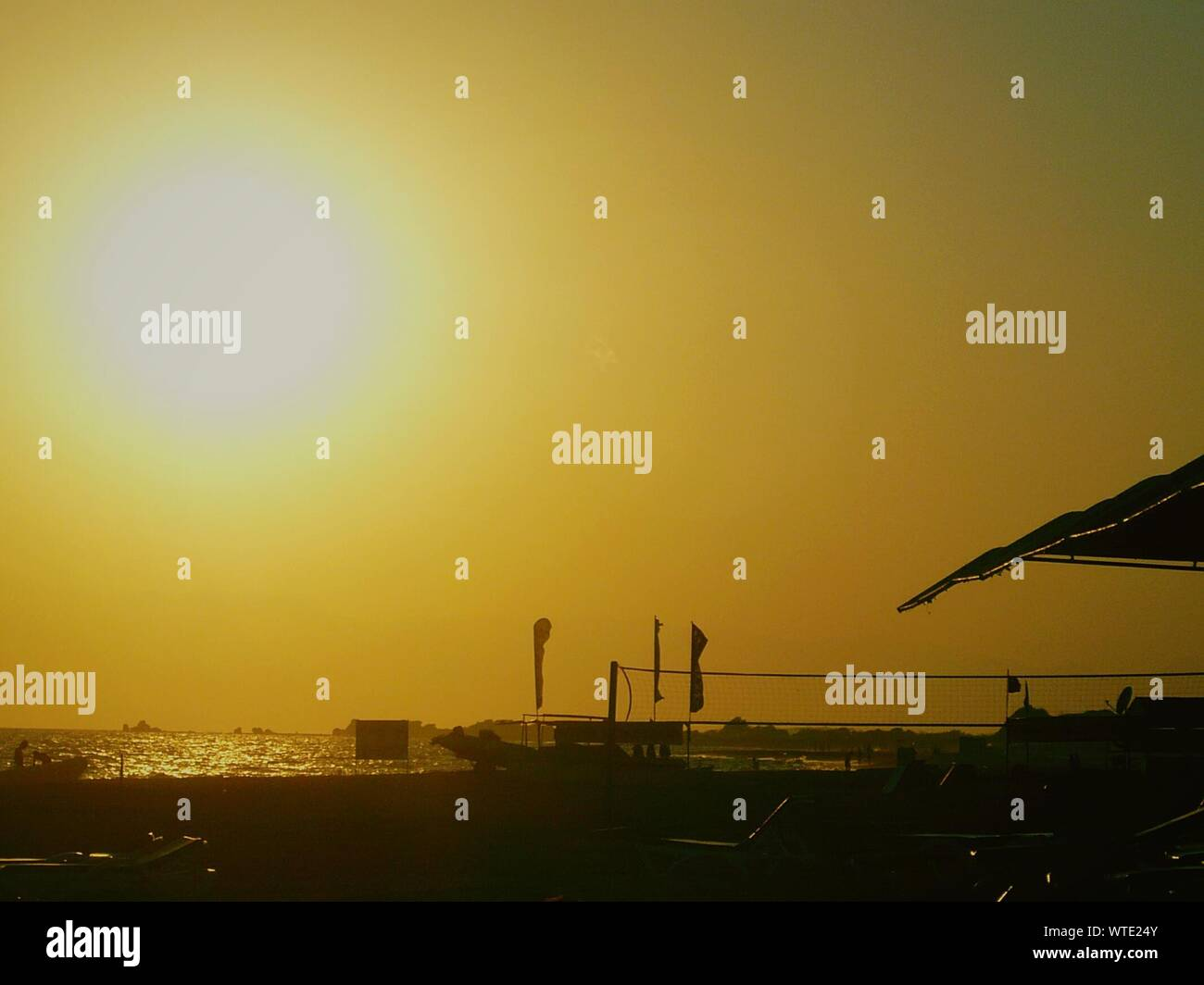 Scenic View Of Beach At Sunset Stock Photo