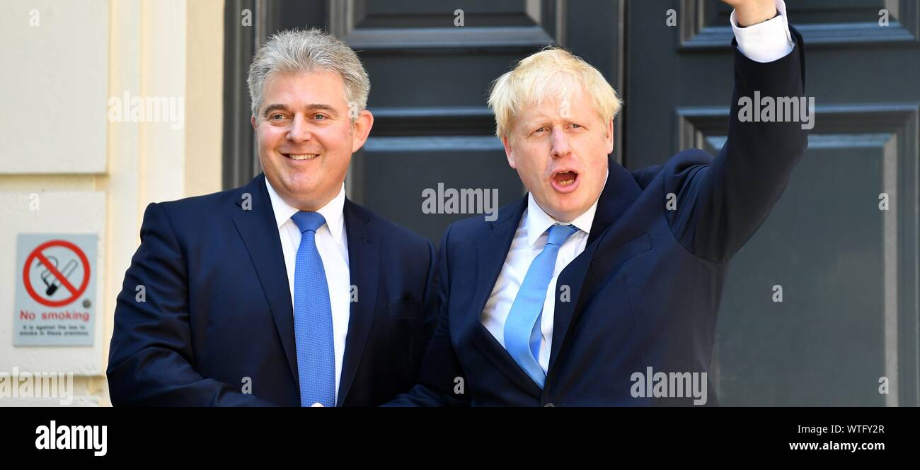 Boris Johnson shakes hands with Chairman of Conservative Party Brandon Lewis as he arrives at Conservative party HQ in Westminster on July 23, 2019. Stock Photo