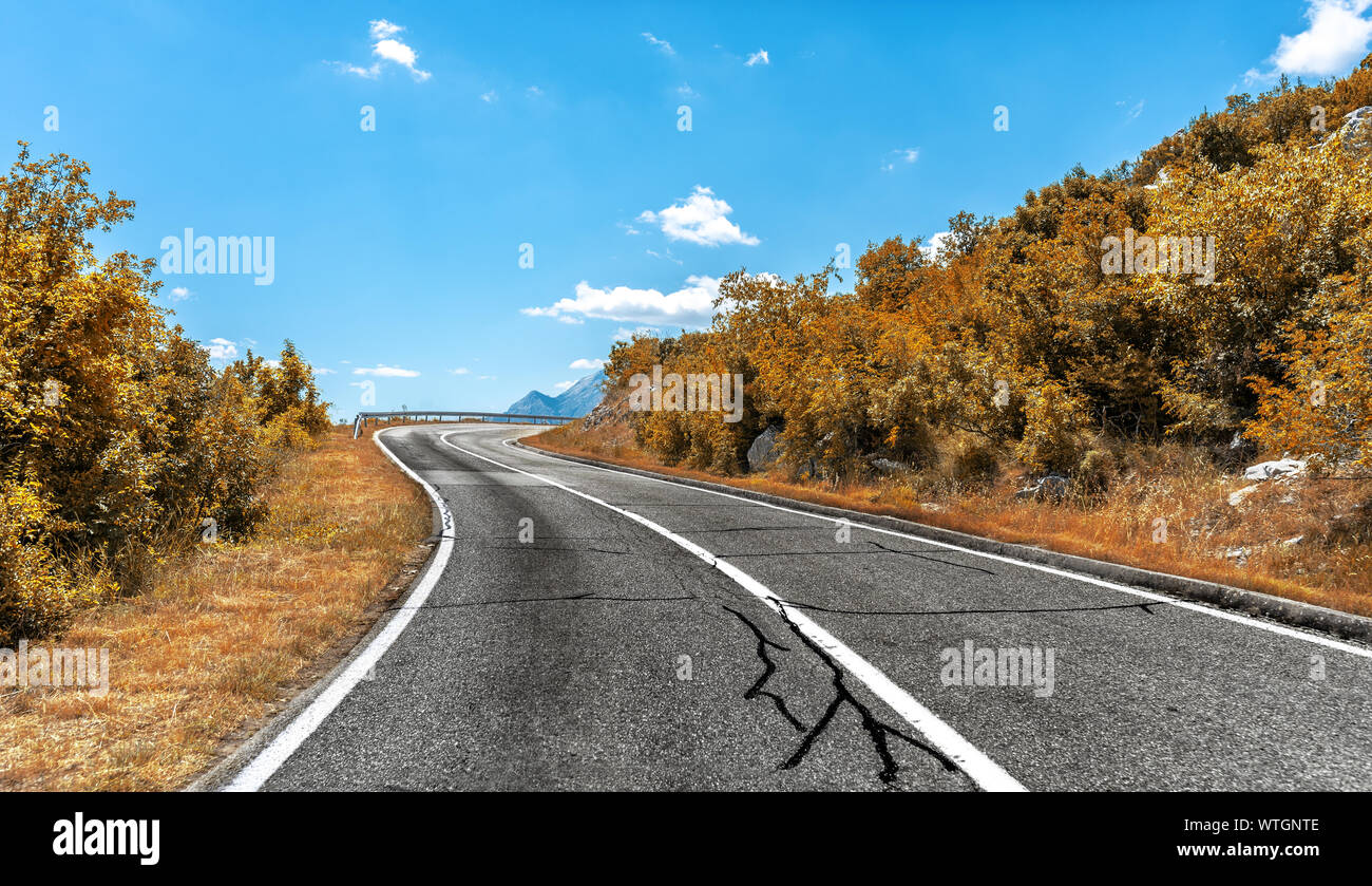 Country highway in the autumn. Road in the fall. Stock Photo