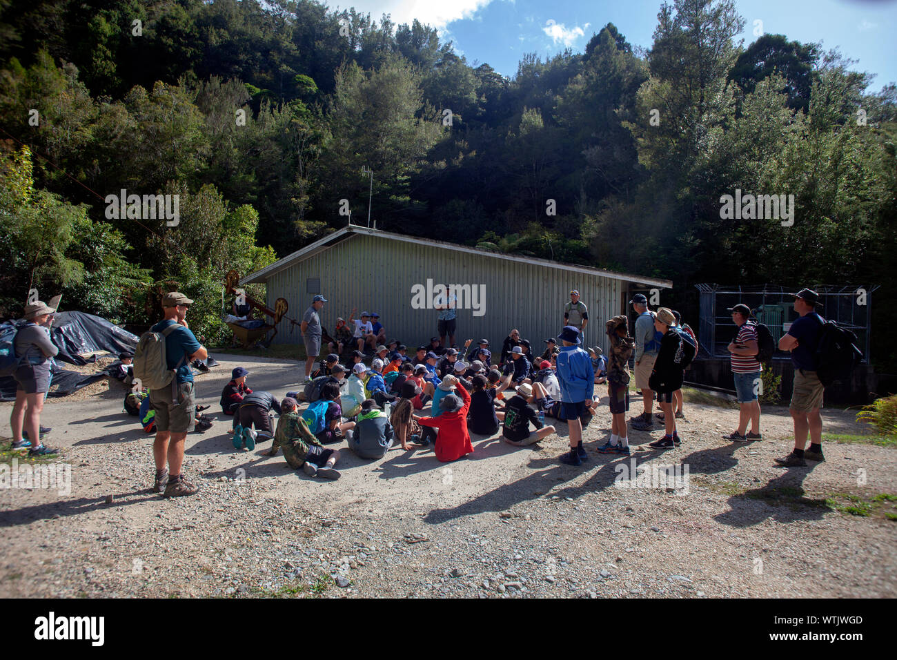 Picture by Tim Cuff - 1 March 2019 - Paul Sangster speaks to a school group visiting the Pupu Hydro scheme, Golden Bay, New Zealand Stock Photo