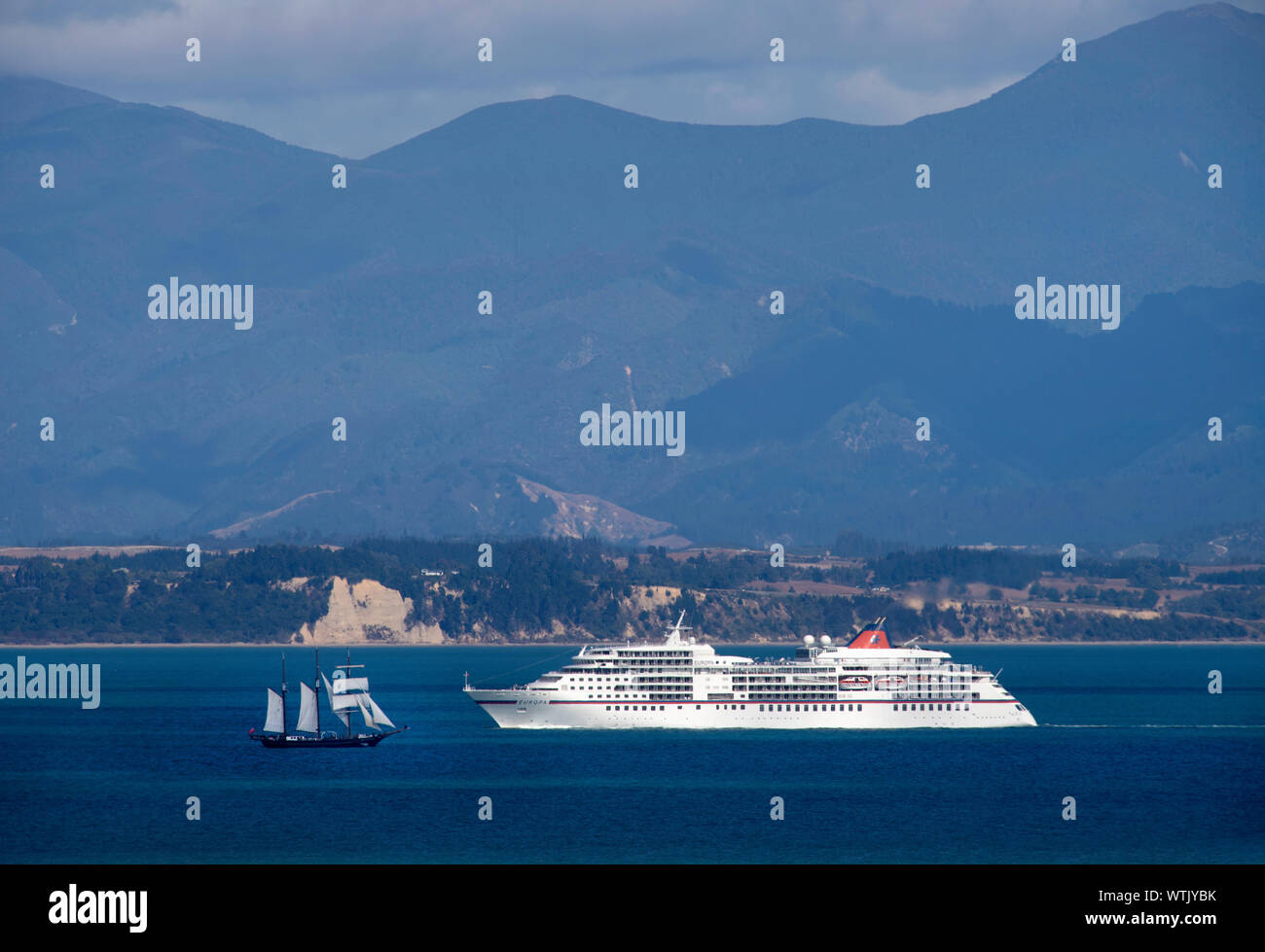 Picture by Tim Cuff - 16 February 2019 - Cruise ship approaching Port Nelson with the sailing ship Spiriti of New Zealand sailing out, Nelson, New Zea Stock Photo