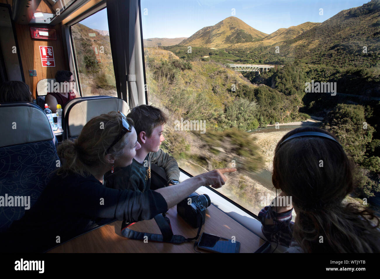 Picture by Tim Cuff - 5 January 2019 - Tranz Alpine train journey from Christchurch to Greymouth, New Zealand: approaching a bridge over the Waimakari Stock Photo