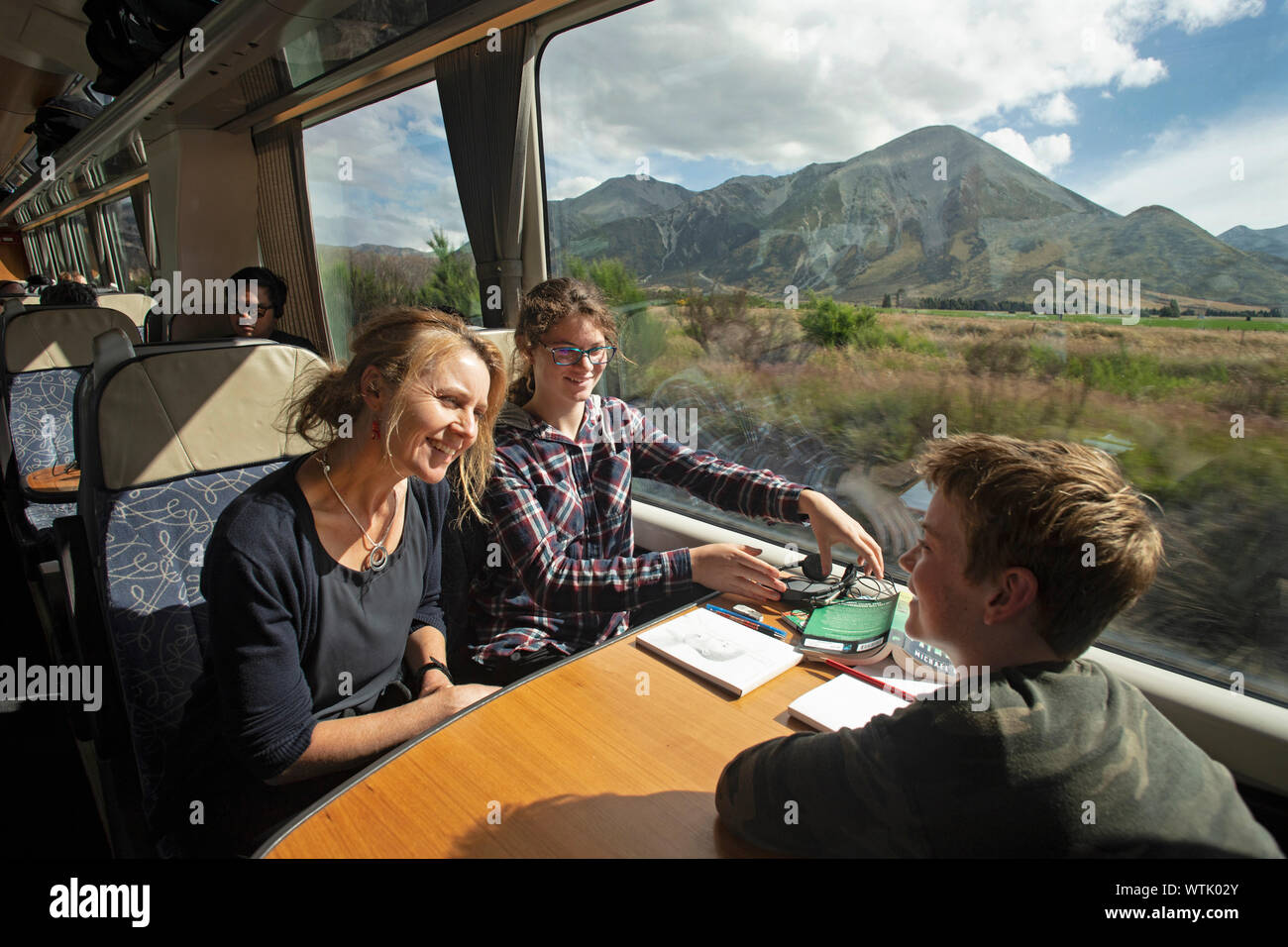 Picture by Tim Cuff - 4 January 2019 - Tranz Alpine train journey from Greymouth to Christchurch, New Zealand: a family enjoying the journey Stock Photo