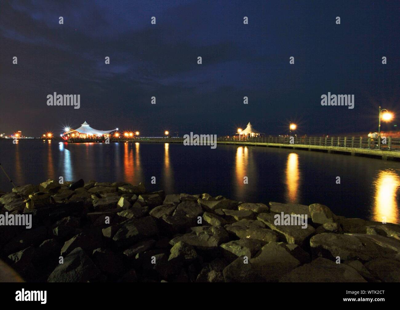 Scenic View Of Illuminated Ancol Dreamland Against Sky At Night Stock Photo