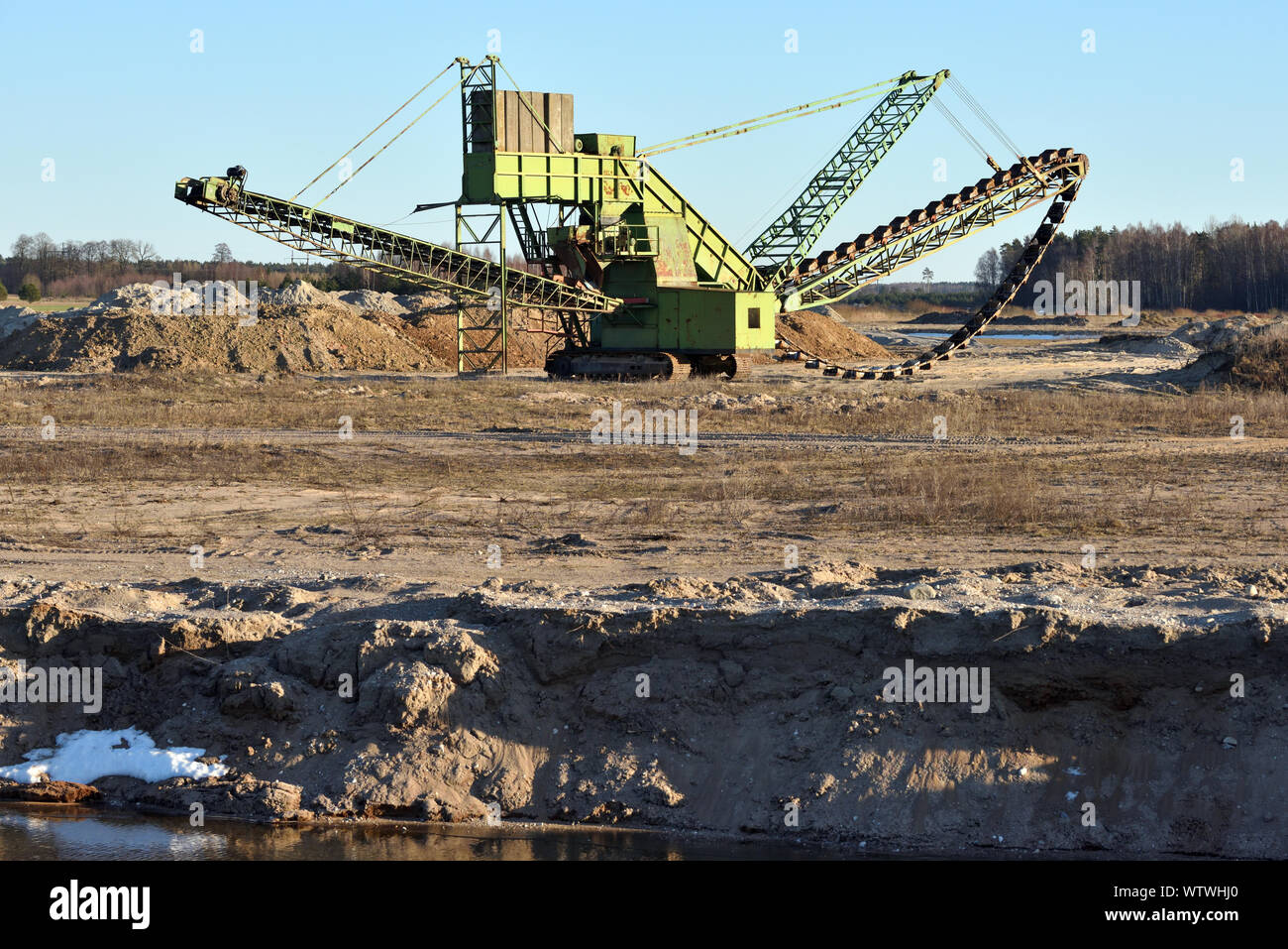 Stone crusher in the quarry. Working mining machine - stone crusher. Quarrying of stones for construction works. Mining industry Stock Photo