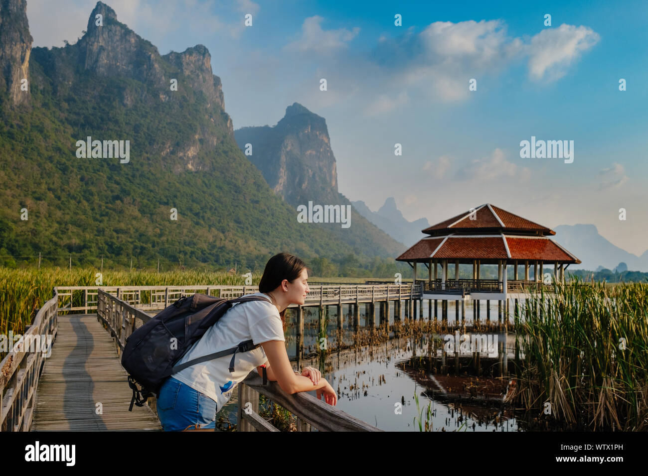 Young woman relaxing in park. Sam Roi Yod National Park, Thailand Stock Photo