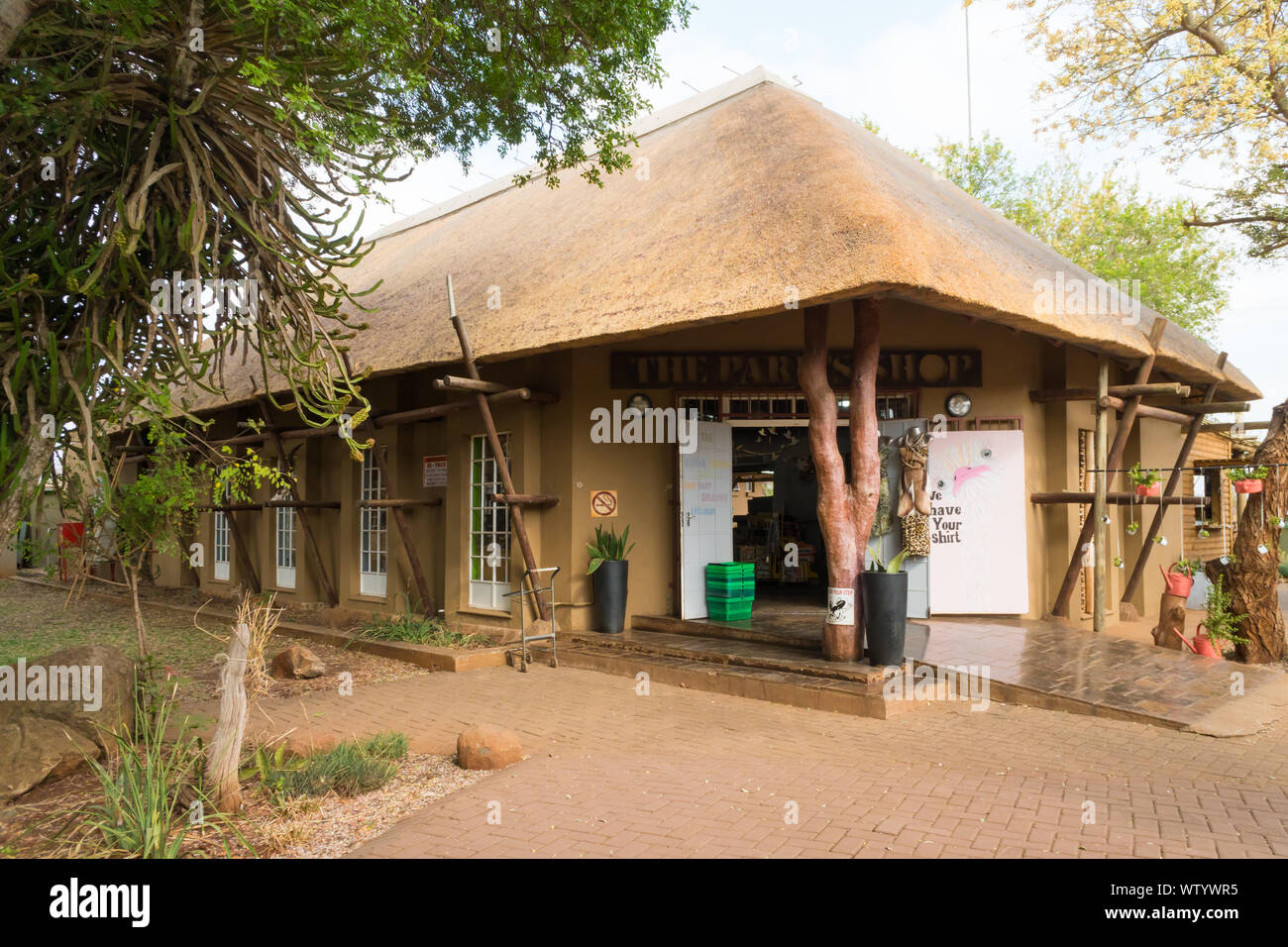 Crocodile Bridge rest camp shop or provisions store under thatch roof in Kruger National Park, Mpumalanga, South Africa Stock Photo