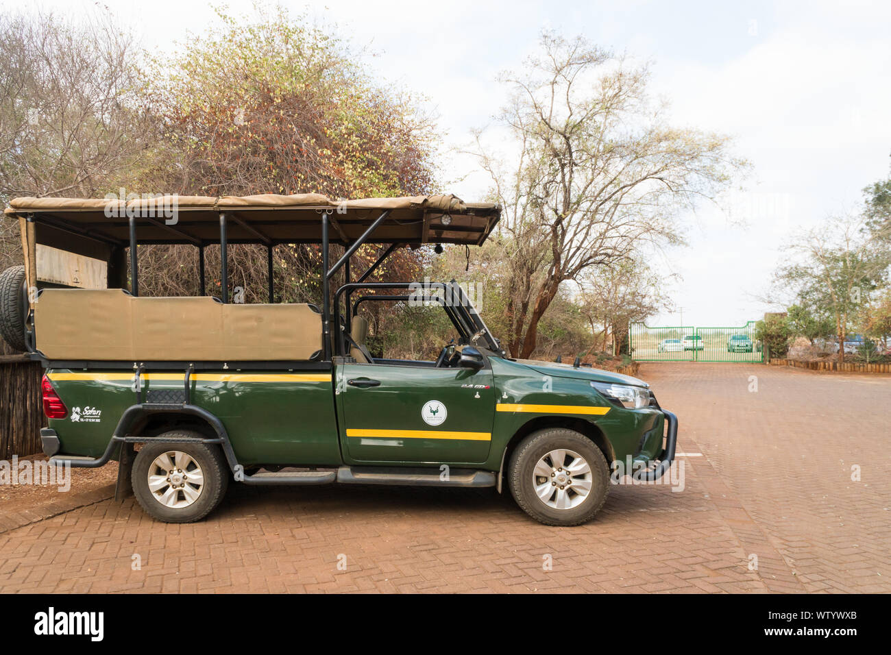 South African National Parks, SANParks safari or game drive vehicle or truck parked at Crocodile Bridge rest camp in Kruger National Park,South Africa Stock Photo