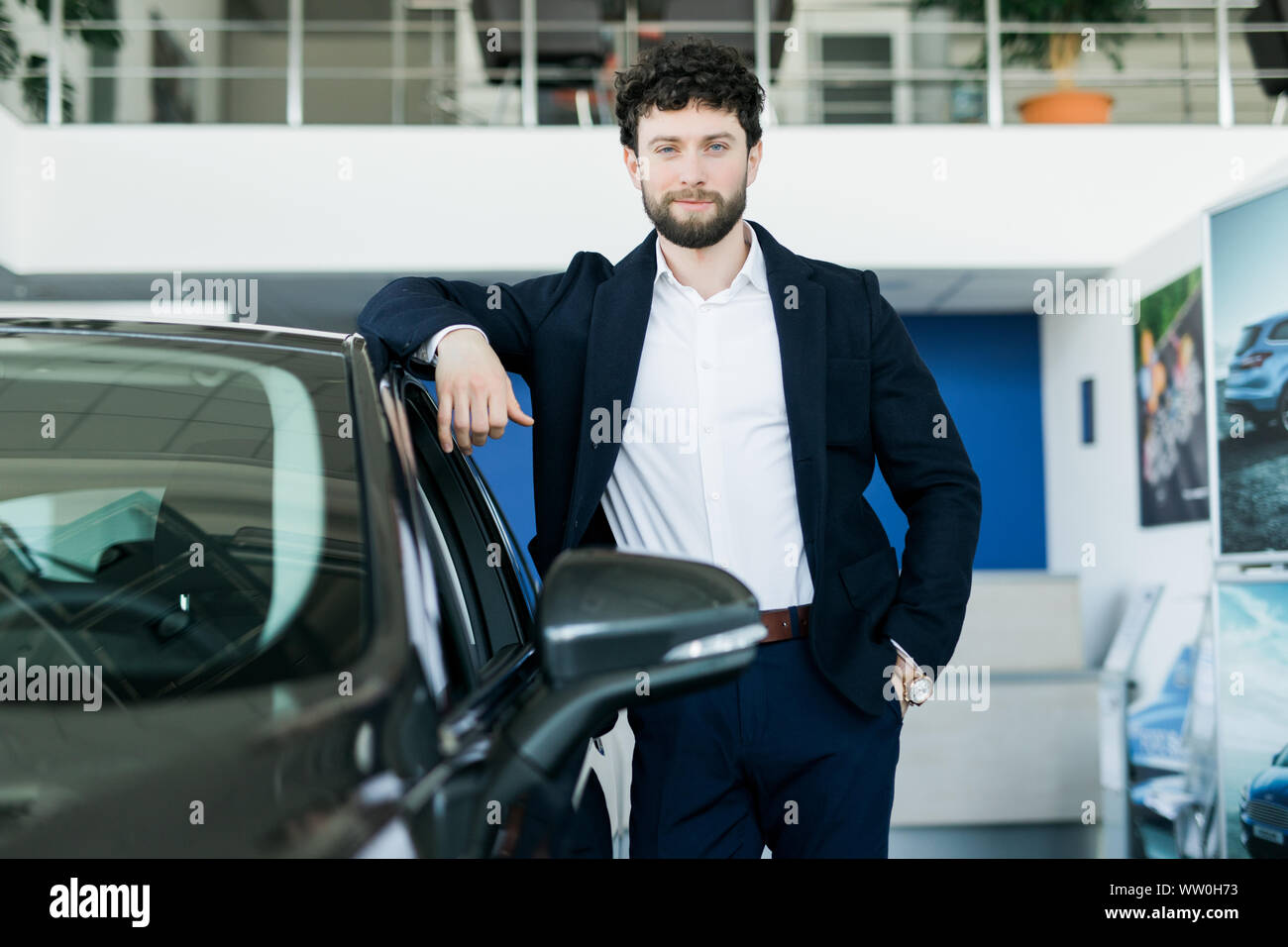 Car Showroom Happy Man With Keys To The Car Of His Dreams Stock Photo Alamy