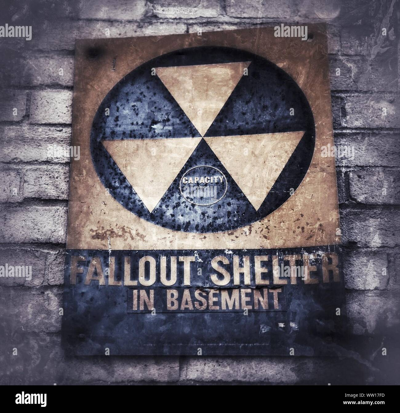 Close-up Of Old Fallout Shelter Sign On Wall Stock Photo