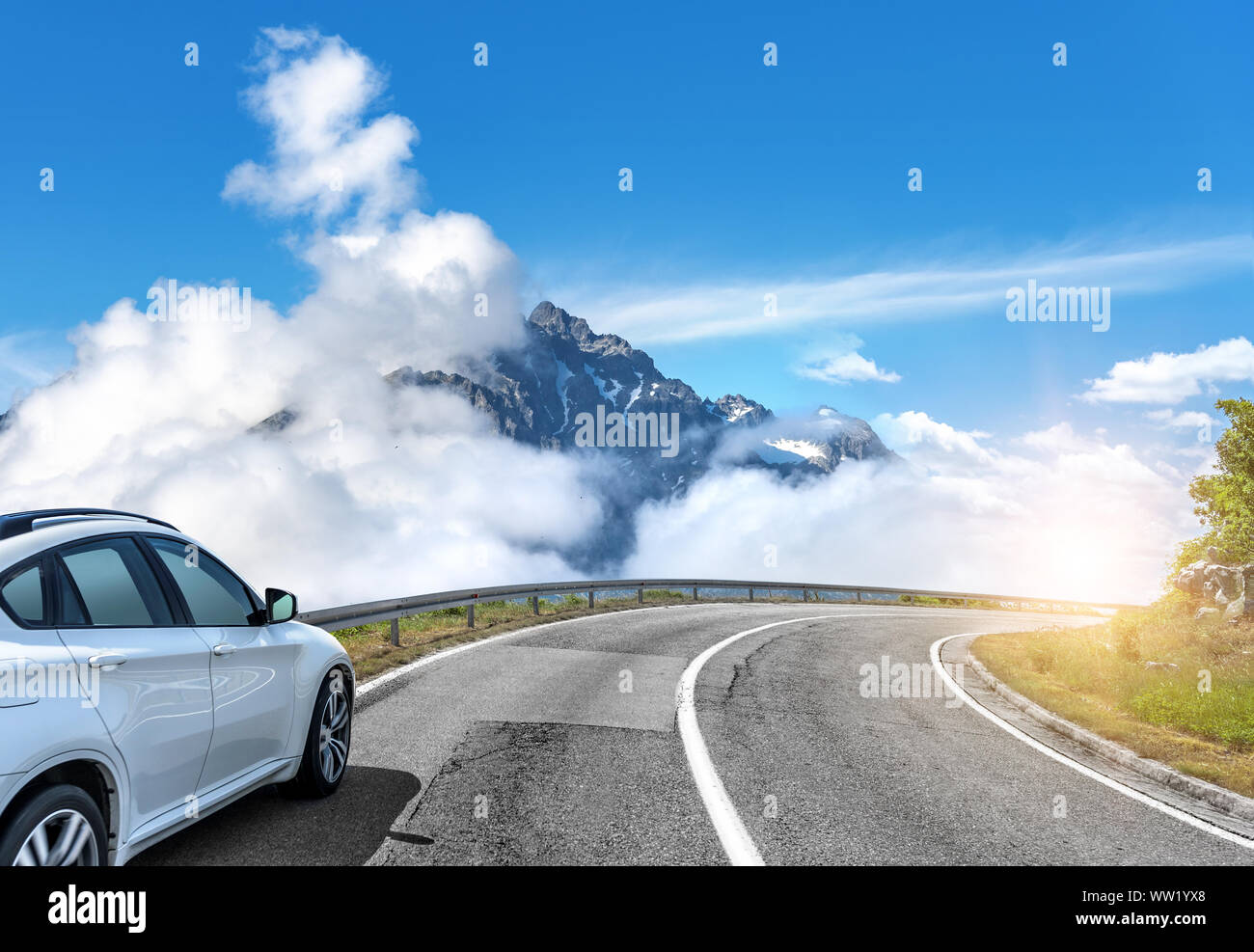 Car moves on the road among the mountains and forests. Stock Photo